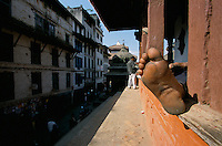 Merchandise carriers resting on a temple at Durbar square in Kathmandu City, Nepal