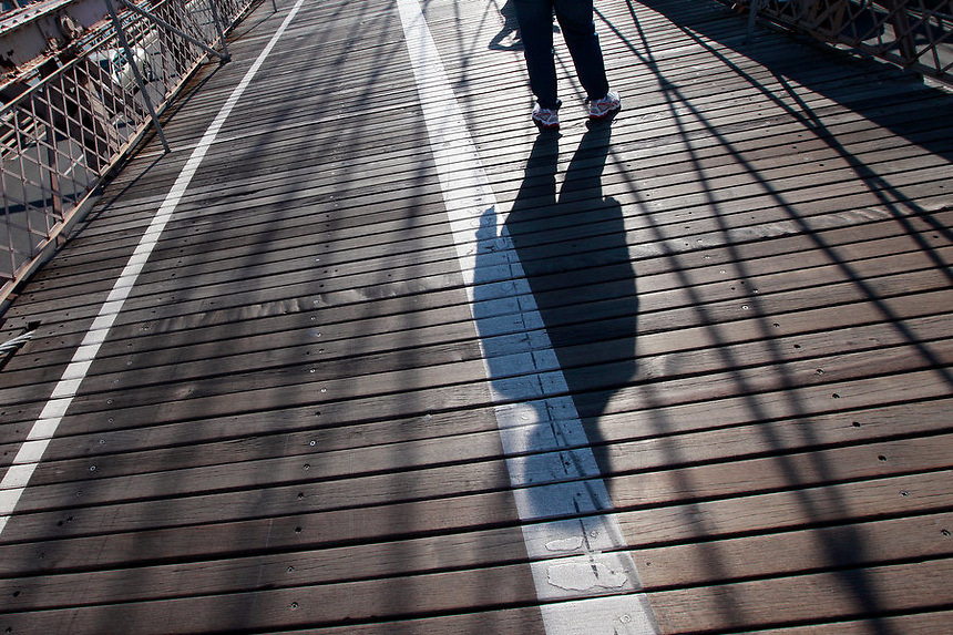 A walk across the Brooklyn Bridge, New York City, on Tuesday, October 18, 2011.