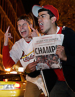 Washington University students , James Mosbacher, 18, left, and Anchit Mehrotra, right, scream at cars on second street in Laclede's Landing after the St. Louis Cardinals won the World Series against the Detroit Tigers on Friday, October 27, 2006.