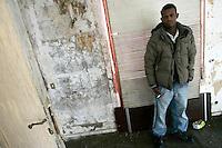 Rifugiati somali nell'ex ambasciata di Somalia a Roma, 29 dicembre 2010..Circa 200 rifugiati somali vivono in condizioni igieniche precarie nell'edificio che ospitava l'ambasciata e che e' stato abbandonato dopo la caduta del governo somalo negli anni Novanta..A Somalian refugee stands inside the former Somalian embassy in Rome, 29 december 2010. About 200 refugees live  in precarious hygienic conditions in the building, which is still the property of the Somali government but was abandoned after the collapse of the government in Mogadishu in the 1990s..© UPDATE IMAGES PRESS/UPDATE IMAGES PRESS/Riccardo De Luca