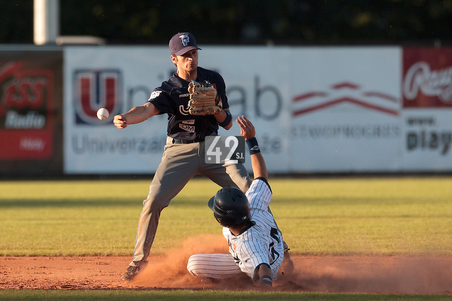 05 June 2010: Livinston Santanielo of Bologna throws the ball to first base over Maxime Lefevre of Rouen for the double play during the 2010 Baseball European Cup match won 10-0 by Fortitudo Bologna over the Rouen Huskies, at the AVG Arena, in Brno, Czech Republic.