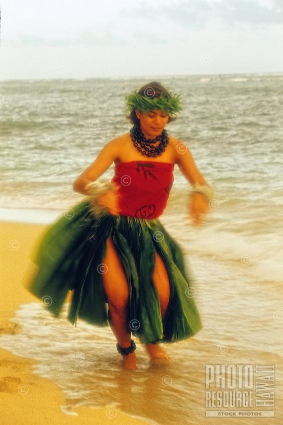 Hula dancer on the beach wearing ti leaf skirt