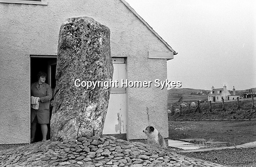 Callanish Standing Stones. An outlying stone marooned on the new Stonefields estate Callanish, Lewis, Shetland Islands 1974...My ref 14/899/,1974,
