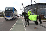 A police horse stands guard as fans arrive by bus during the Barclays Premier League match at Old Trafford. Photo credit should read: Philip Oldham/Sportimage