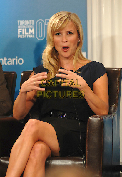 """REESE WITHERSPOON.at the press conference for her new film """"Rendition"""" during the 32nd Annual Toronto International Film Festival, Toronto, Canada, 7th September 2007..half length sitting hands funny face mouth.CAP/TL.©Tony Lee/Capital Pictures."""