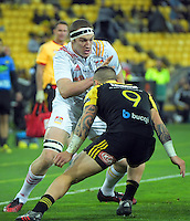 TJ Perenara lines up a tackle on Brodie Retallick during the Super Rugby semifinal match between the Hurricanes and Chiefs at Westpac Stadium, Wellington, New Zealand on Saturday, 30 July 2016. Photo: Dave Lintott / lintottphoto.co.nz