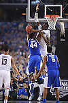 07 April 2014: Dakari Johnson (44) of the University of Kentucky is defended by Amida Brimah (35) of the University of Connecticut during the 2014 NCAA Men's DI Basketball Final Four Championship at AT&T Stadium in Arlington, TX. Connecticut defeated Kentucky 60-54 to win the national title. Peter Lockley/NCAA Photos