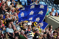 A Bristol Rugby fan in the crowd waves a flag in support. Aviva Premiership match, between Wasps and Bristol Rugby on September 18, 2016 at the Ricoh Arena in Coventry, England. Photo by: Patrick Khachfe / JMP