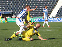 Player/Coach Jim Goodwin is late with a tackle on Sammy Clingan in the Kilmarnock v St Mirren Scottish Professional Football League Premiership match played at Rugby Park, Kilmarnock on 13.9.14.