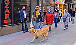 Turks walk on the streets, some wearing masks as a precaution against the spread of the coronavirus disease (COVID-19) in Istanbul, Turkey, on May 11, 2020. Photo by Mahmoud abu Salama