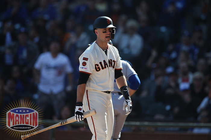 SAN FRANCISCO, CA - SEPTEMBER 28:  Buster Posey #28 of the San Francisco Giants reacts after striking out against the Los Angeles Dodgers during the game at Oracle Park on Saturday, September 28, 2019 in San Francisco, California. (Photo by Brad Mangin)