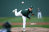 Pitcher Adam Berghorst (44) of the Michigan State Spartans delivers a pitch in a game against the Merrimack Warriors on Saturday, February 22, 2020, at Fluor Field at the West End in Greenville, South Carolina. Merrimack won, 7-5. (Tom Priddy/Four Seam Images)