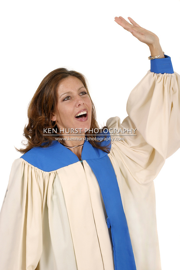 Woman in church choir robe with her arms raised singing in charismatic praise to God.  Shot isolated on white background.  Horizontal orientation.