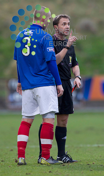 Referee Crawford Allan not happy with Kenneth Adamson during the Irn Bru Division One Partick Thistle v Cowdenbeath at Firhill Stadium..Universal News And Sport (Scotland). 26 January 2013 www.unpixs.com.