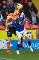 16th November 2019; Tannadice Park, Dundee, Scotland; Scottish Championship Football, Dundee United versus Queen of the South; Mark Reynolds of Dundee United competes in the air with Gary Oliver of Queen of the South  - Editorial Use