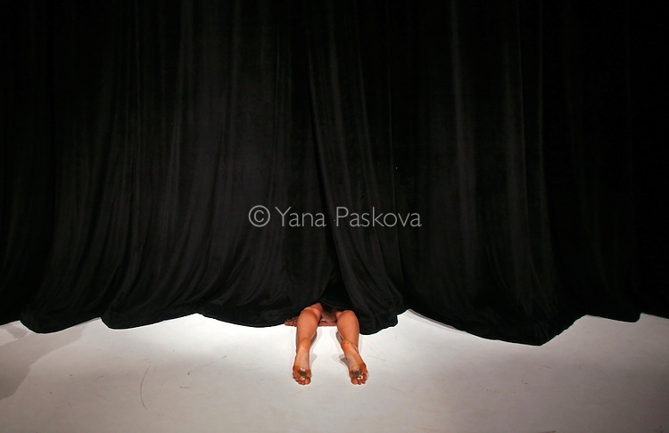 Curtains close on Julia Burrer as a dress rehearsal for the Colleen Thomas Dance program begins at the Dance Theater Workshop in Manhattan, New York on Friday, July 17, 2009.  (Photo by Yana Paskova for The New York Times)