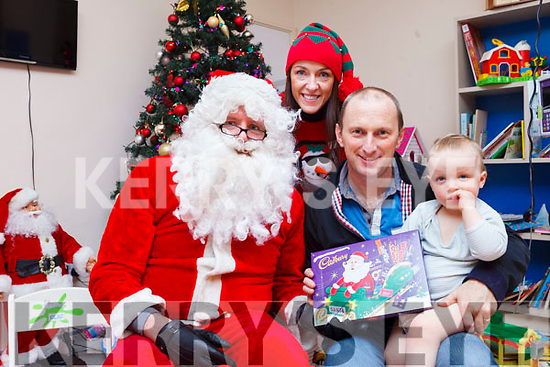 Children from the Cashel Ward in University Hospital Kerry were delighted to Santa stop by on Friday afternoon. Pictured with Anne the elf and Santa were: Monty Boyd with his 22 month old son Thomas from Lixnaw.