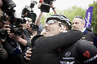 race winner Fabian Cancellara (CHE/TrekFactoryRacing) finds his wife immediately after the finish line with the press immediately swamping them<br /> <br /> Ronde van Vlaanderen 2014