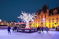 Belgium, West-Flanders, Bruges: Christmas Ice skating rink in the Market Place