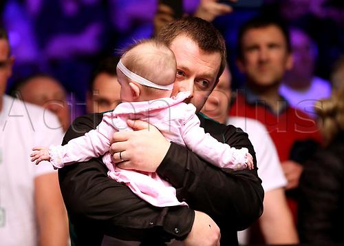 21st January 2018, Alexandra Palace, London, England; 2018 Dafabet Masters Final, Mark Allen versus Kyren Wilson; Mark Allen hugs his baby girl Harleigh in celebration after defeating Kyren Wilson 10-7