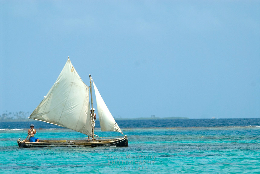 Traditional sailing boat and crew of two men, Comarca De Kuna Yala, San Blas Islands, Panama