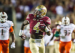 Calvin Cook scampers 72 yards for a touchdown on his first carry in the first half of an NCAA college football game against Miami in Tallahassee, Fla., Saturday, Oct. 10, 2015.   The Florida State Seminoles defeated the Miami Hurricanes 29-24.