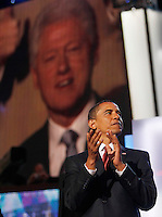 8/27/08 8:57:00 PM -- Denver, CO, U.S.A.Barak Obama claps for former president Bill Clinton after taking the stage Wednesday at the DNC. ..Pat Shannahan/ Gannett.