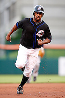 June 29, 2009:  Right Fielder Emil Brown (63) of the Buffalo Bisons runs to third base during a game at Coca-Cola Field in Buffalo, NY.  The Bisons are the International League Triple-A affiliate of the New York Mets.  Photo by:  Mike Janes/Four Seam Images