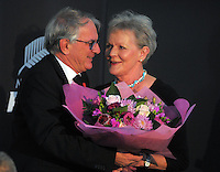 NZ Rugby chairman Brent Impey presents a bouquet of flowers to Marilyn Macrae, wife of outgoing president Ian Macrae. The 2015 New Zealand Rugby Union Annual General Meetin at the New Zealand Rugby Union Head Office, Wellington, New Zealand on Thursday, 23 April 2015. Photo: Dave Lintott / lintottphoto.co.nz