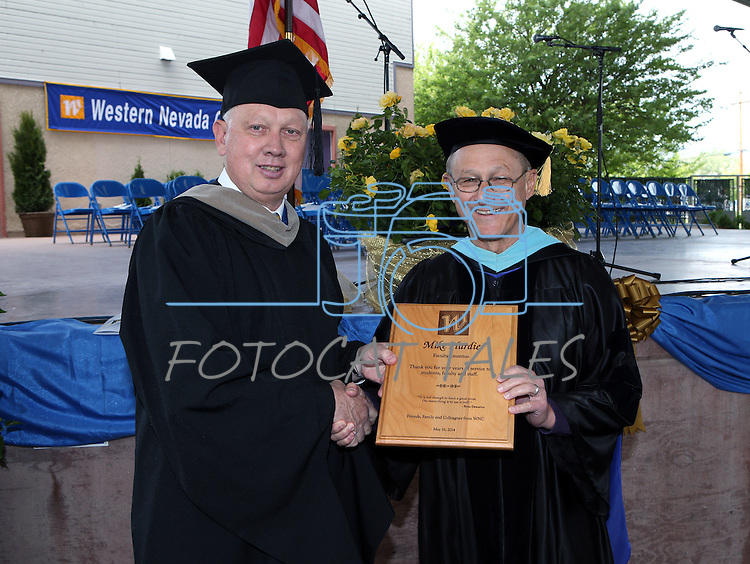 Interim President Chester Burton recognizes Faculty Emeriti recipient Mike Hardie before the Western Nevada College commencement at the Pony Express Pavilion, in Carson City, Nev., on Monday, May 19, 2014. <br /> Photo by Cathleen Allison/Nevada Photo Source