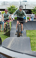 NWA Democrat-Gazette/BEN GOFF @NWABENGOFF<br /> Riders use a pump track from Progressive Bike Ramps Friday, May 10, 2019, at the Women Shred Village during the Bentonville Film Festival.