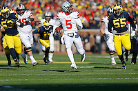 Ohio State Buckeyes quarterback Braxton Miller (5) watches the Michigan Wolverines defense as he runs in a touchdown in the first quarter of the college football game between the Ohio State Buckeyes and the Michigan Wolverines at Michigan Stadium in Ann Arbor, MI Saturday afternoon, November 30, 2013. The Ohio State Buckeyes defeated the Michigan Wolverines 42 - 41. (The Columbus Dispatch / Eamon Queeney)