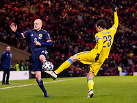 19th November 2019; Hampden Park, Glasgow, Scotland; European Championships 2020 Qualifier, Scotland versus Kazakhstan; Steven Naismith of Scotland blocks Yuriy Logvinenko of Kazakhstan clearance  - Editorial Use