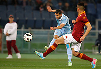 Calcio, Serie A: Roma vs Lazio. Roma, stadio Olimpico, 8 aprile 2013..Lazio midfielder Antonio Candreva kicks the ball as AS Roma defender Leandro Castan, right, challenges him during the Italian Serie A football match between AS Roma and Lazio at Rome's Olympic stadium, 8 April 2013..UPDATE IMAGES PRESS/Riccardo De Luca