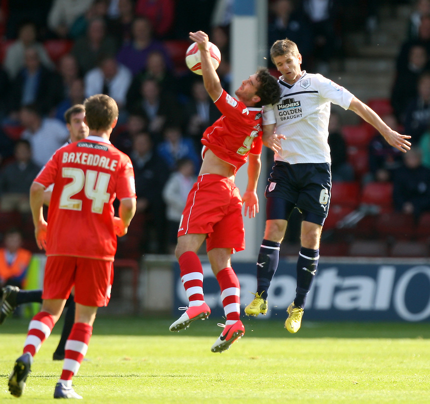 Preston North End's Shane Cansdell-Sheriff jumps with Walsall's Will Grigg..Football - npower Football League Division One - Walsall v Preston North End - Saturday 22nd September 2012 - Banks's Stadium - Walsall..