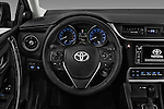 Car pictures of steering wheel view of a 2017 Toyota Corolla-iM CVT-Automatic 5 Door Hatchback Steering Wheel