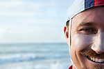 The face of a surf lifesaver wearing a traditional swimming cap at Cronulla Beach.  Sydney, New South Wales, AUSTRALIA.