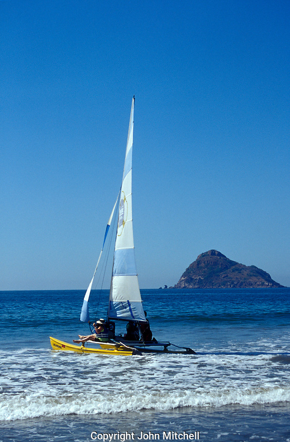 Catamaran sailboat with Isla de Chivos or Goat Island in background,  Mazatlan, Sinaloa, Mexico