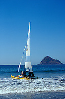 Catamaran sailboat with Isla de Chivos or Goat Island in background,  Mazatlan, Sinaloa, Mexico