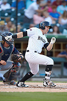Mason Robbins (27) of the Charlotte Knights follows through on his swing against the Toledo Mud Hens at BB&T BallPark on June 22, 2018 in Charlotte, North Carolina. The Mud Hens defeated the Knights 4-0.  (Brian Westerholt/Four Seam Images)