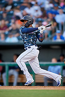 Jacksonville Jumbo Shrimp center fielder Monte Harrison (3) follows through on a swing during a game against the Mobile BayBears on April 14, 2018 at Baseball Grounds of Jacksonville in Jacksonville, Florida.  Mobile defeated Jacksonville 13-3.  (Mike Janes/Four Seam Images)