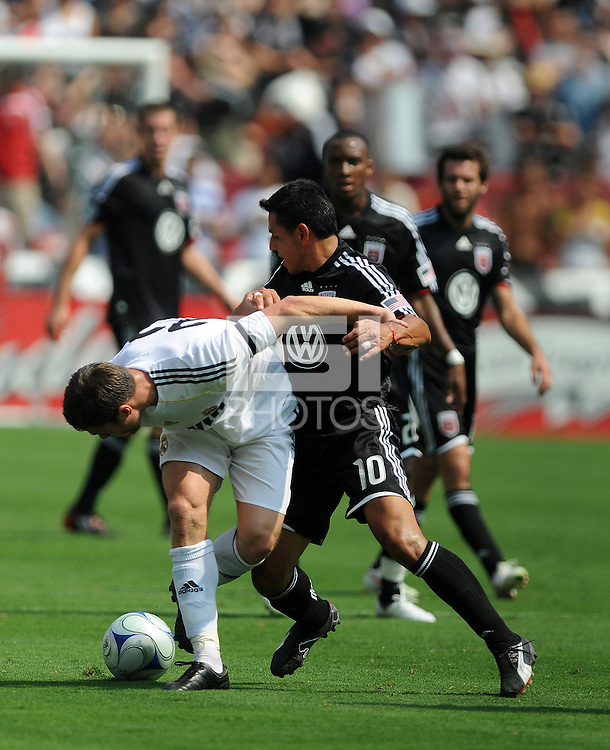 Real Madrid midfielder Xabi Alonso (22) versus DC United midfielder Christian Gomez (10). Real Madrid defeated DC United 3-0 at FedEx Field, Sunday August 9, 2009 in an International Friendly.