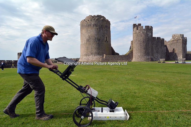 Pictured: A surveyor at Pembroke Castle, west Wales, UK. STOCK PICTURE<br /> Re: Researchers believe they might have uncovered the location of Henry VII's birthplace at Pembroke Castle.<br /> Aerial photographs from 2013 gave glimpses of what lay beneath the surface, with parch marks revealing possible buildings.<br /> A geophysical survey has now confirmed the outline of a late-medieval building in the outer ward, where the king could have been born.<br /> Neil Ludlow, consultant archaeologist, said it shone new light on the castle.<br /> Much of the interior of the castle, which dates from the 11th Century, was destroyed after the Middle Ages.