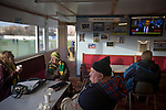 Away supporters gathering in the tea room inside the ground before the Boxing Day derby match between Runcorn Town and visitors Runcorn Linnets at the Pavilions, Runcorn, in a top-of the table North West Counties League premier division match. Runcorn Linnets won 1-0 and overtook their neighbours at the top of the league in a game watched by 803 spectators. Runcorn Linnets were a successor club to Runcorn FC, one of England foremost non-League clubs of the 1970s and 1980s.