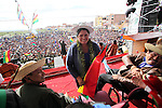 Native Bolivian senator Leonida Zurita smiles as she attends the ceremony of the New Constitution of Bolivia signed by President Evo Morales at El Alto, in the surroundings of La Paz, February 7, 2009. The new Constitution marks a new relationship between the Indian people, their communal justice, regional autonomy, and respecting their cultures. Photo by Heriberto Rodriguez