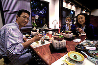 Japanese Family Enjoying Ryokan Meal - Most Japanese inns or ryokan include a large multi-course dinner as part of the set with various courses served on a panoply of dishes and ceramics.  An experience not to be missed...