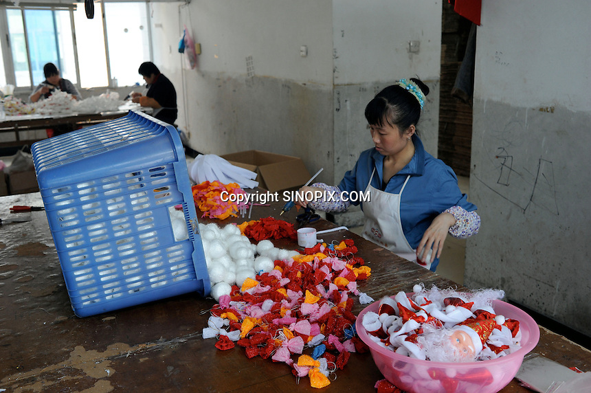 Christmas decorations and ornaments are made in a small house factory in Yi Wu, China.  Yi Wu exports 40-50 % of the entire European Christmas decorations and 70 % of US and Mexico's Christmas gifts come from Yi Wu, where factories are large and small like this one with just 12 workers.