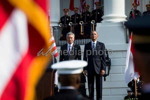 United States President Barack Obama and Prime Minister Lee Hsien Loong of Singapore during official welcoming ceremonies on the South Lawn of the White House in Washington, DC on August 2, 2016. Lee is on a State Visit to the United States. Photo Credit: Pete Marovich/CNP/AdMedia