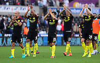 (L-R) Pablo Zabaleta, Fernando, Jesus Navas, Aleksandar Kolarov and John Stones of Manchester City thank their away supporters after the Premier League match between Swansea City and Manchester City at The Liberty Stadium in Swansea, Wales, UK. Saturday 24 September 2016