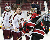 Andie Anastos (BC - 23), Erin Kickham (BC - 3), Sarah Foss (NU - 42) - The Boston College Eagles celebrate winning the 2014 Beanpot championship on Tuesday, February 11, 2014, at Kelley Rink in Conte Forum in Chestnut Hill, Massachusetts.